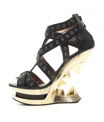 Hades TAUNT/BLK Gold wedge heel with an inspiring edge accented with metal eyelets equipped with straps. Gold finish ankle buckle for added support and style